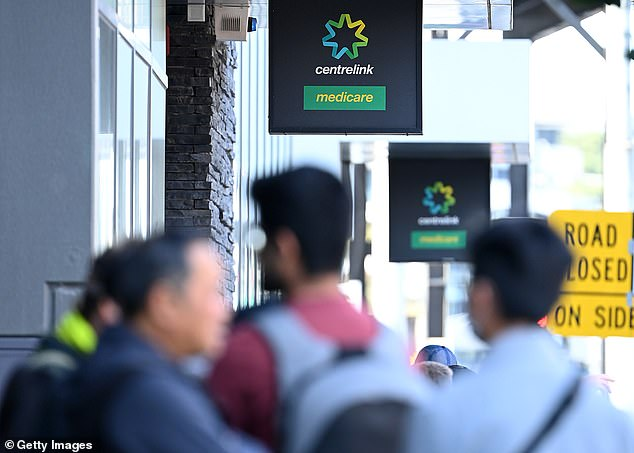 People line up outside the Centrelink Office In Melbourne on Tuesday