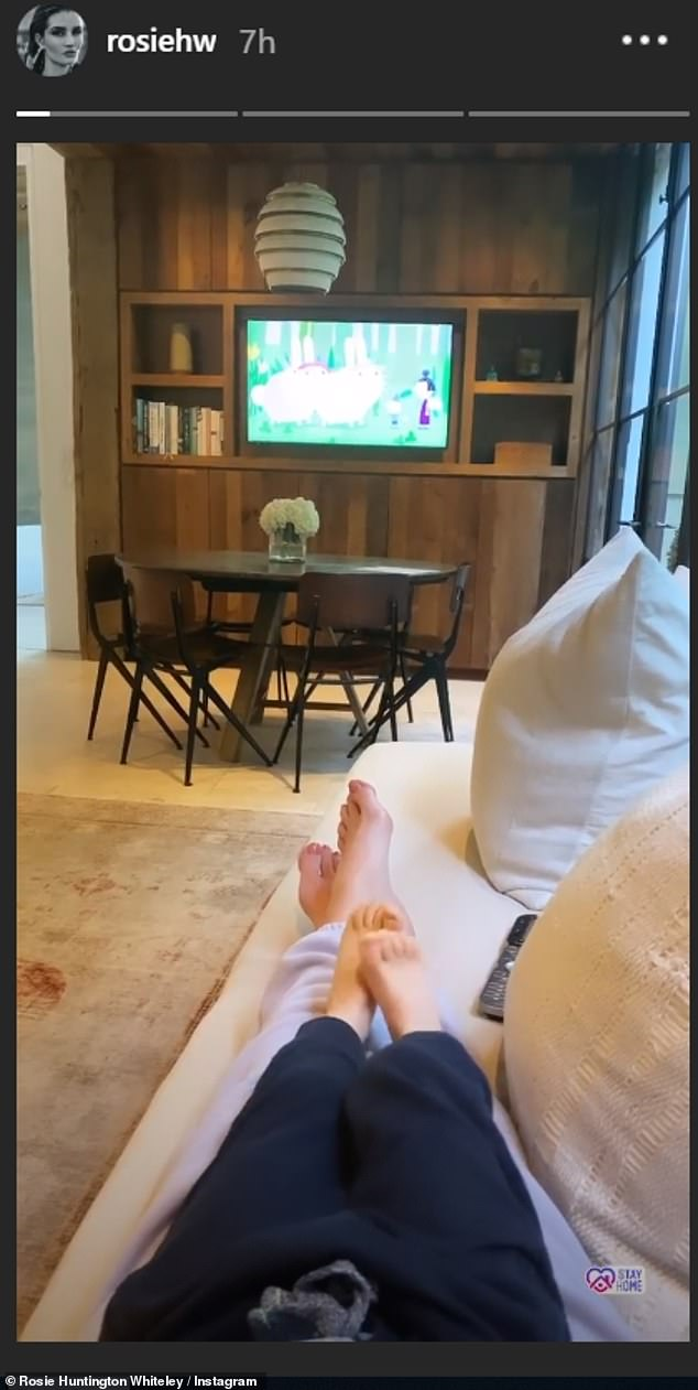 Sweet:Rosie later shared a sweet Instagram video of her and Jack snuggling on the sofa watching cartoons, zooming in on her son's feet as which lay on top of his mother's