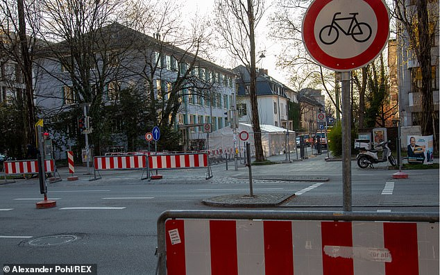 Barricades in front of a coronavirus testing centre in Munich, with streets mostly deserted