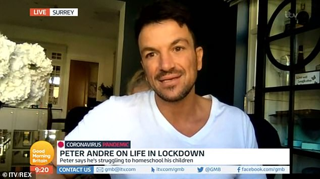 Honest: Peter Andre told GMB on Wednesday he and his doctor wife Emily have been staying in separate rooms to protect their children from coronavirus... as he admitted he is 'worried for her safety'
