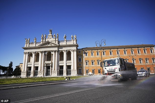 Italy has now overtaken China as the country with the most coronavirus deaths. In the picture above, a truck drives past St. John Lateran Basilica spraying disinfectant as a preventive measure against the spread of the new coronavirus in Rome on Wednesday
