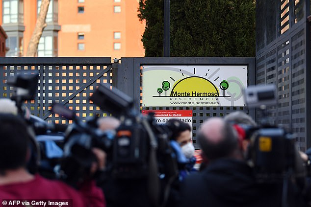 Journalists gather at the entrance to the Monte Hermoso home in Madrid last week as relatives of elderly residents who died inside look for answers