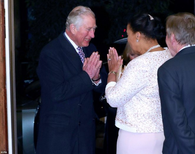 Prince Charles is greeted by Baroness Scotland as he arrives with the Duchess of Cornwall for the Commonwealth Reception at Marlborough House in London on March 9