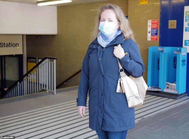 Ernesta Juskatie, 38, a dental nurse, is taking the underground to get to work