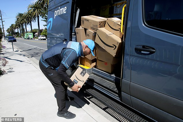 Dr John Torres has revealed that the coronavirus can live up to 24 hours on cardboard packages. An Amazon delivery driver is seen handling packages in California on Monday