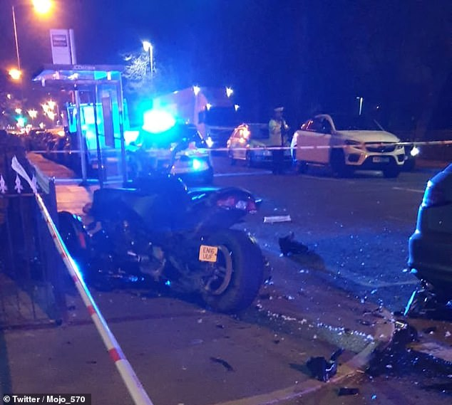 The road in Bury was left strewn with debris after the crash, which happened last night