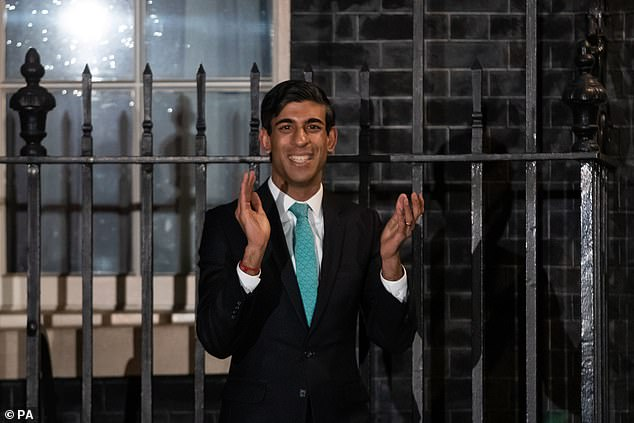 Chancellor Rishi Sunak outside 10 Downing Street, London, joining in with a national applause for the NHS to show appreciation for all NHS workers who are helping to fight the Coronavirus