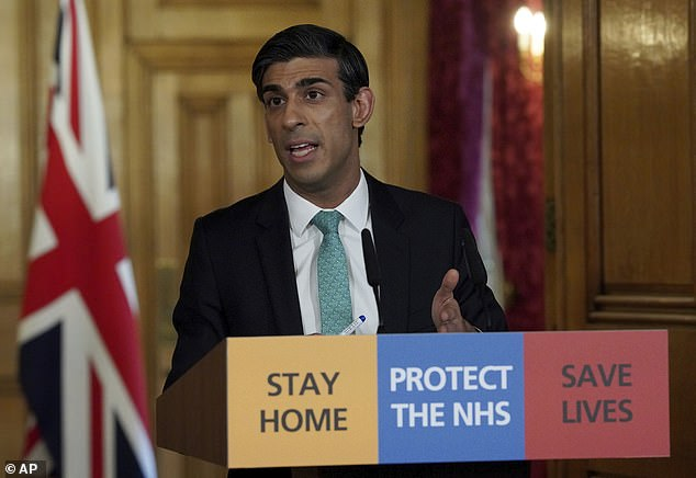 In this image made available by British government because no media allowed into 10 Downing Street because of the coronavirus pandemic, showing Chancellor of the Exchequer Rishi Sunak holding a digital press conference about the COVID-19 coronavirus, in 10 Downing Street, London today