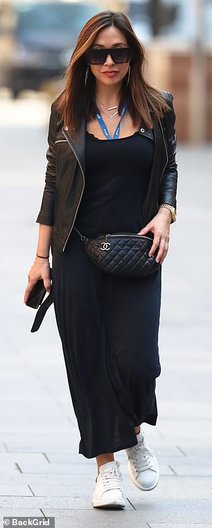 Details: Myleene accessorised her look with a quilted black bumbag, white trainers and chunky dark sunglasses