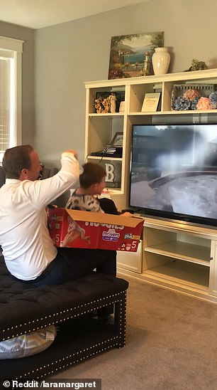Fun! He put five-year-old son James in an empty box in front of a POV video of the ride on the television