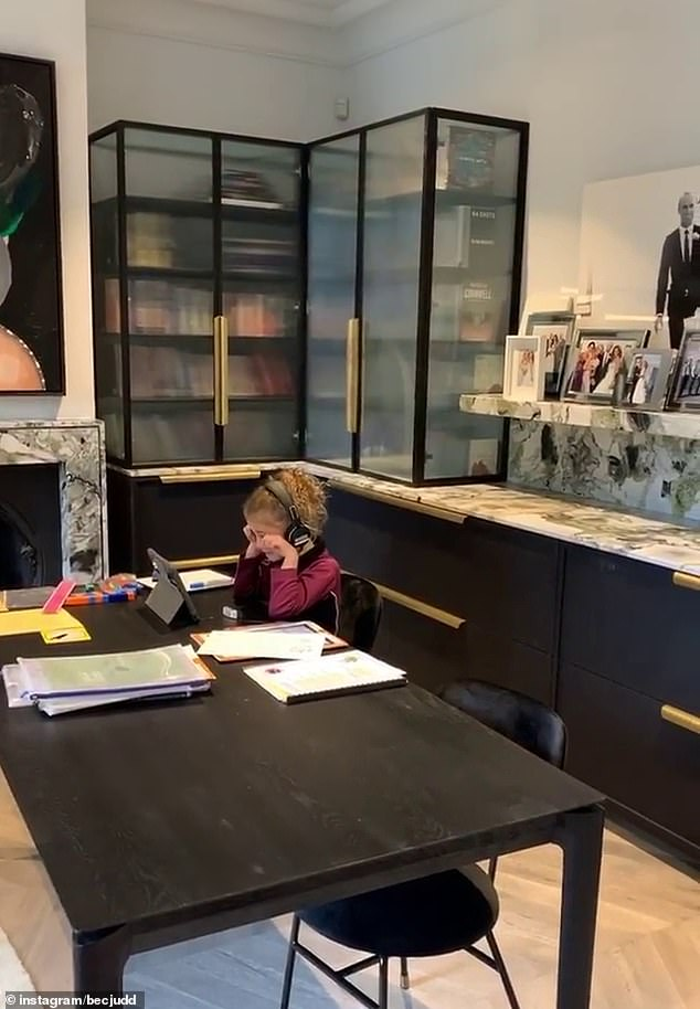 Keeping her schooling up: Billie could be seen talking to classmates on an iPad