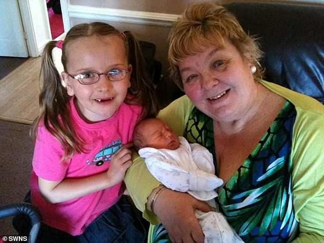 Susan Nelson with her granddaughter Ellie and grandson Edward.17 family members are now showing symptoms of Covid-19 after going to the funeral in Yardley Wood