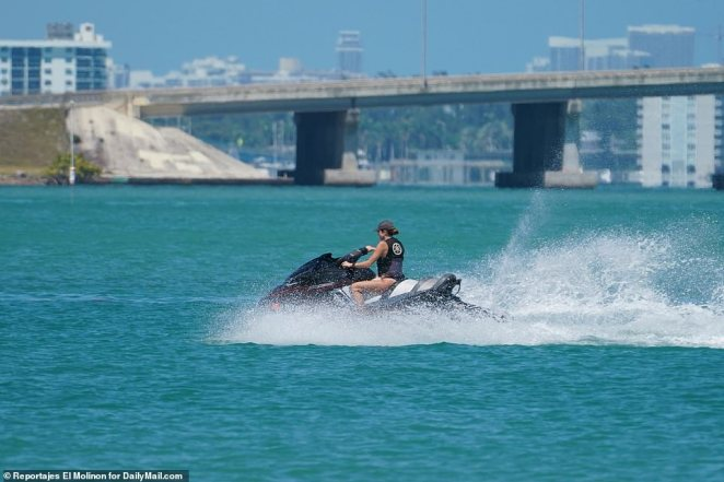 A young woman jet skis in Biscayne Bay on Sunday as South Floridians enjoy fun in the sun
