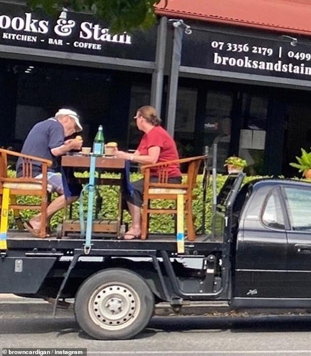 A couple set up their own makeshift outdoor dining table on the back of their ute so they could eat breakfast outside a cafe despite strict social distancing rules