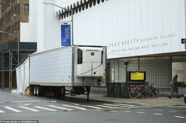 There have been 5,582 confirmed cases of the coronavirus in Manhattan as of late Sunday. The above image shows a refrigerated truck and tent outside Lenox Health Hospital in Greenwich Village on Sunday