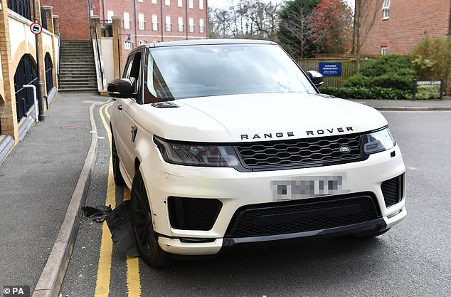 The white Range Rover is pictured after the crash in the Dickens Heath area of Solihull