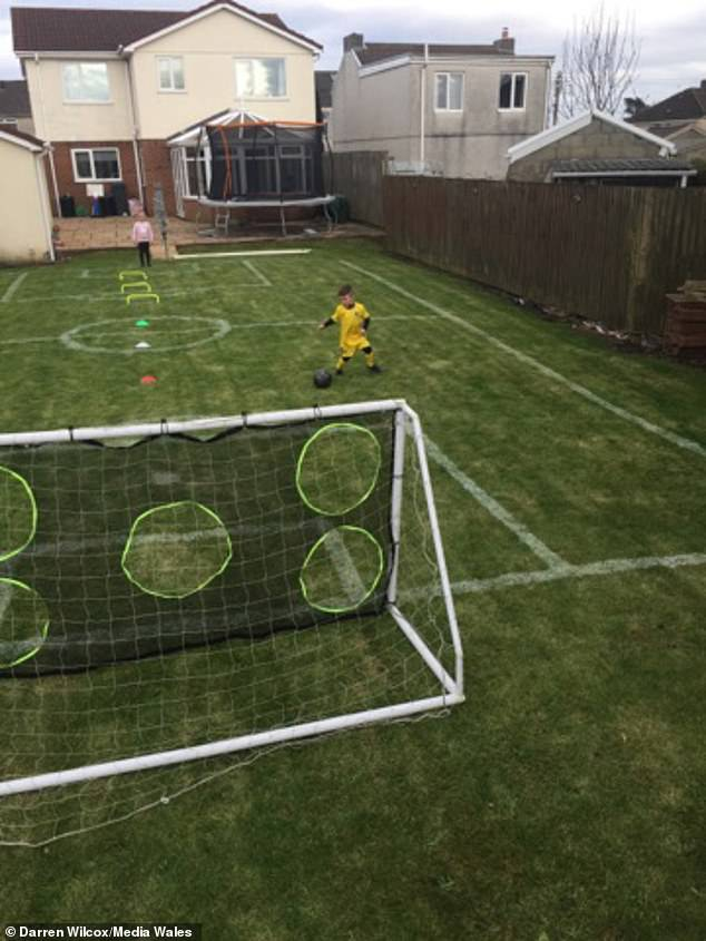 It comes as dad-of-two Darren Wilcox, 39, turned his garden into a pitch (pictured) to entertain his children over the weekend, after days cooped up in self-isolation