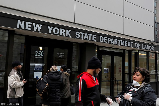 People gather at the entrance for the New York State Department of Labor offices in Brooklyn