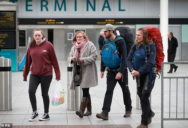 Passengers who traveled on a repatriation flight from Peru arrive at Gatwick Airport in Sussex as the government continues to assist tens of thousands of Britons stranded abroad by the coronavirus pandemic