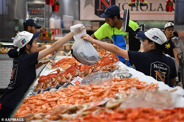Pictured: Sydney Fish Market in December. The government is paying for freight planes to send $800million worth of seafood overseas to combat the impact of the coronavirus