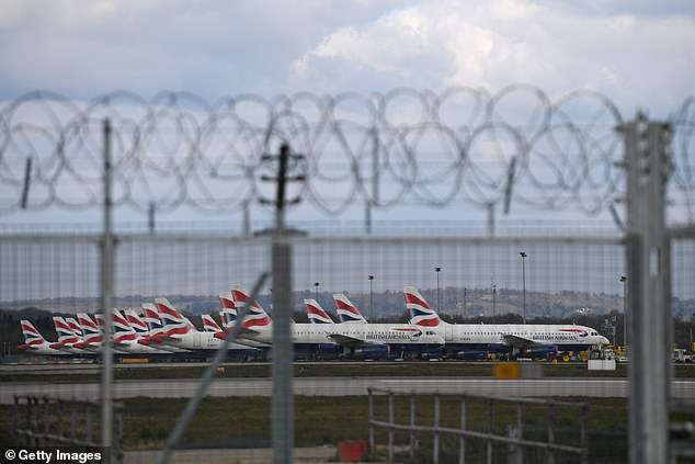 British Airways planes are parked in a row at Gatwick Airport. Airline cut all flights to and from Gatwick Airport on Tuesday as COVID-19 continues to strangle the aviation industry
