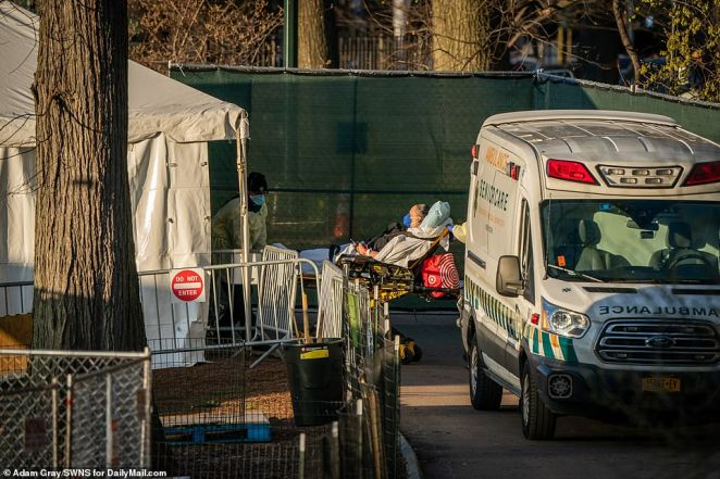 A COVID-19 patient arrives at a field hospital built by Christian humanitarian organization Samaritans Purse in Central Park