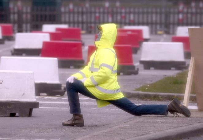 Staff yesterday were pictured stretching their legs while there was little activity at the site