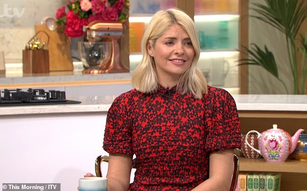 Tear: Holly Willoughby was moved at This Morning on Thursday when co-host Phillip Schofield admitted he was missing their team