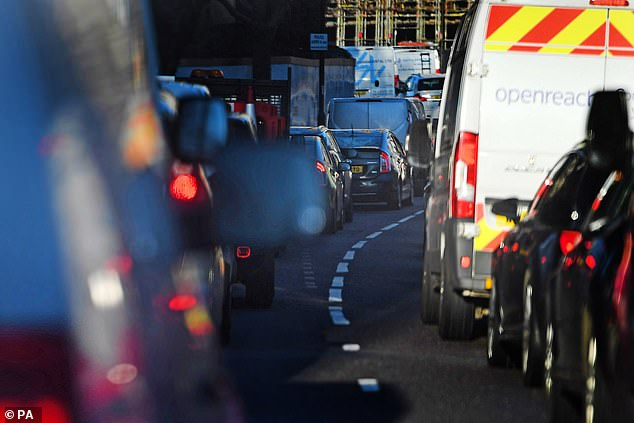Photographs show heavy traffic on a main road in Wapping, east London, on Wednesday heading for the capital at rush hour despite the UK lockout