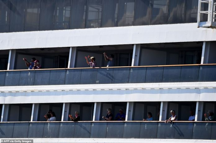 Rotterdam passengers cheer as they head to Port Everglades wharf in Fort Lauderdale