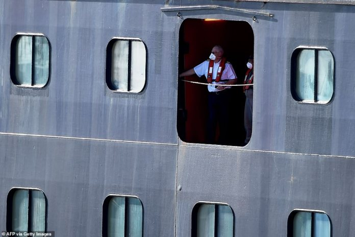 Rotterdam staff members watch as they head to Port Everglades wharf Thursday afternoon
