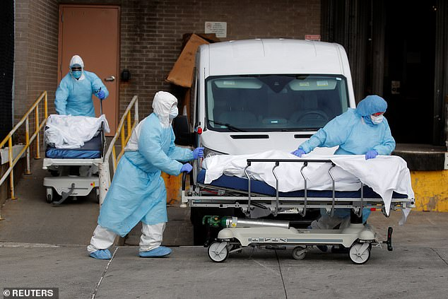 Health care workers roll up bodies of deceased Wyckoff Heights Medical Center during coronavirus outbreak
