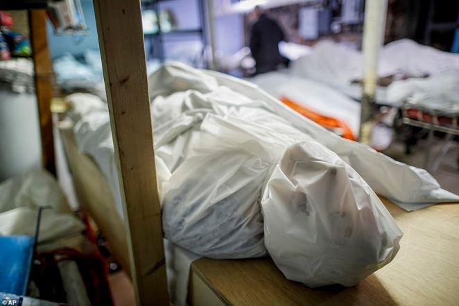 Bodies are wrapped in protective plastic in a holding facility at Daniel J. Schaefer Funeral Home, Thursday, in Brooklyn.The company is equipped to handle 40-60 cases at a time but amid the pandemic, it was taking care of 185 Thursday morning
