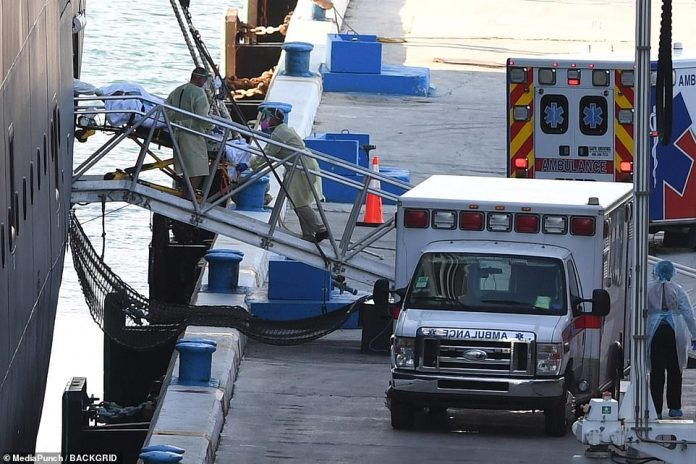 A gravely ill passenger was expelled from MS Zaandam by medical workers dressed in hazardous materials and placed in an ambulance in Port Everglades, Port Lauderdale, yesterday. The vessel has been cleared to dock after being turned back by 14 countries