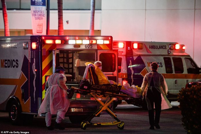 A passenger is carried by stretcher in an ambulance. They are taken to Broward Health Medical Center for treatment
