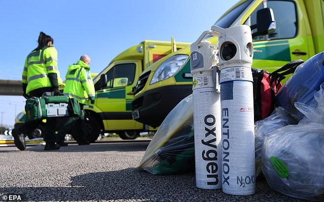 Trusts have been advised to calculate exactly how many patients can be treated using oxygen machines at once. Pictured, oxygen tanks being delivered to the new NHS Nightingale hospital at the ExCel centre