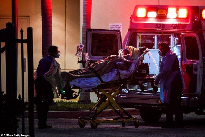 Sick passenger transferred from MS Zaandam to waiting ambulance in Port Everglades yesterday