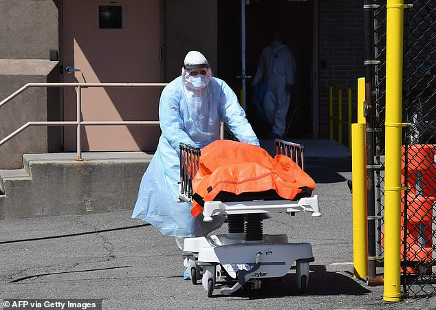Medical staff move bodies from the Wyckoff Heights Medical Center to a refrigerated truck on April 2in Brooklyn, New York.The US now has the most coronavirus cases in the world