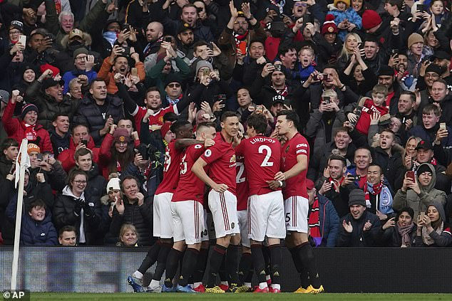 Manchester United has become the first Premier League team to cut player salaries