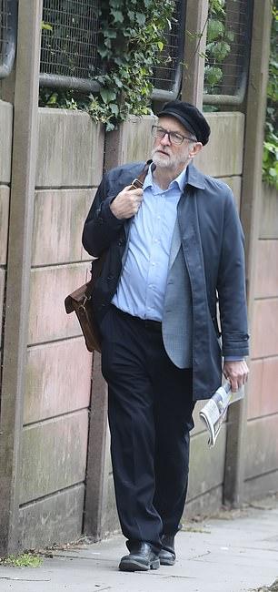 Mr Corbyn walking