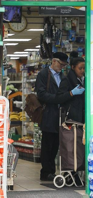 Mr Corbyn buying a paper