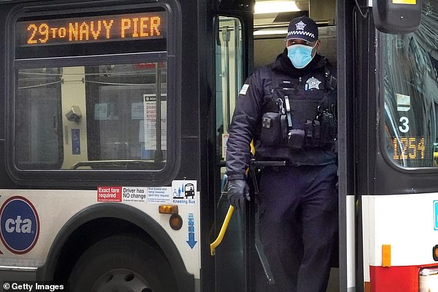 A Chicago police officer is pictured on patrol last week. More than 60 officers in the department have tested positive to COVID-19