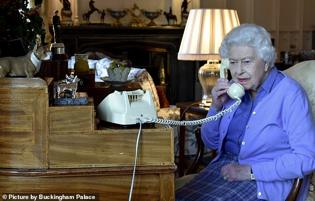 The Queen's two weeks of virtual self-isolation at Windsor Castle were far from straightforward after one of her main employees was diagnosed with Covid-19. Pictured: Queen speaks to Boris Johnson of Windsor Castle for his weekly coronavirus hearing