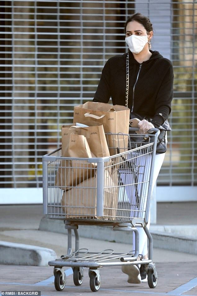 Staying safe: Lauren Silverman took extra precaution when she headed out to do her food shop in Malibu on Friday