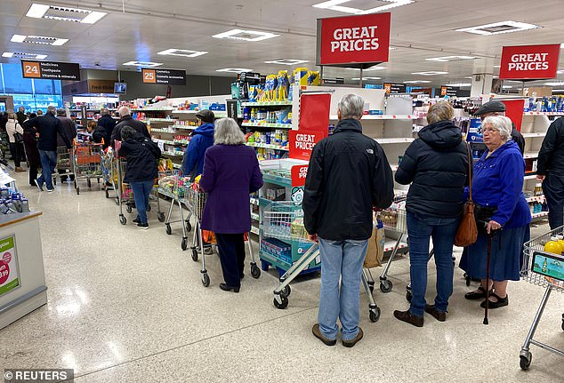 People queue inside a Sainsbury's supermarket in Watford as the spread of the coronavirus disease continues, Watford, Britain, March 19, 2020