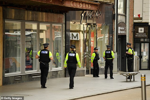 Police officers patrol the high street on April 02, 2020 in Exeter, England