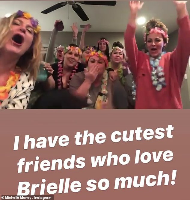 Shoot for her: another video featured a multitude of Michelle's friends, all dressed in leis and flower wreaths as they sang Happy Birthday to her daughter