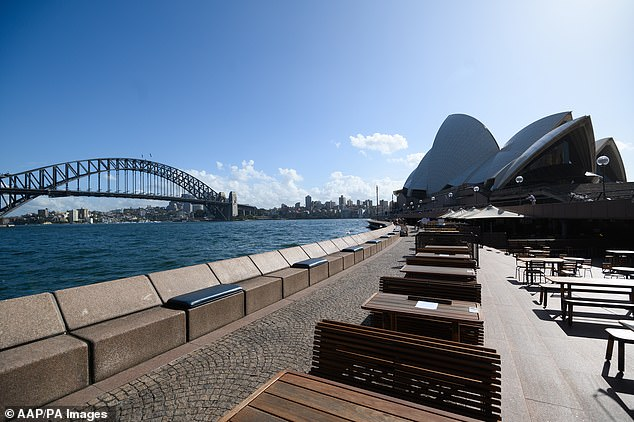 Dining-out was banned indefinitely across Australia last month as part of the governments strict social distancing measures to curb the spread of the deadly disease (Pictured: Empty tables at the Opera Bar restaurant, Sydney)