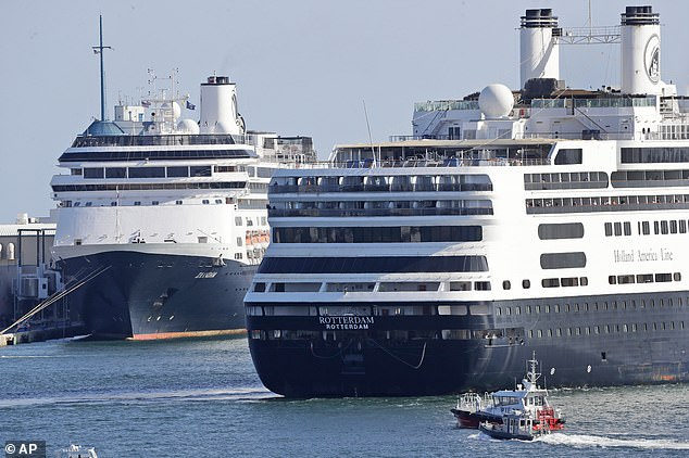 MS Rotterdam is pictured arriving at the port after the twin ship Zaandam. The boat is photographed off the coast of Florida before arriving in the city. 1381 people on board the ship