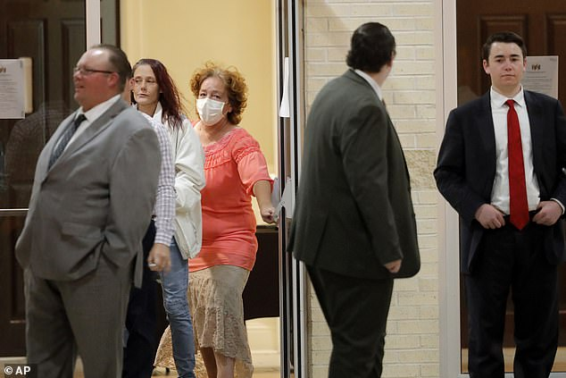 Congregants leave after an evening service at Life Tabernacle Church in Louisiana on Tuesday. Pastor Tony Spell held the service despite facing misdemeanor charges